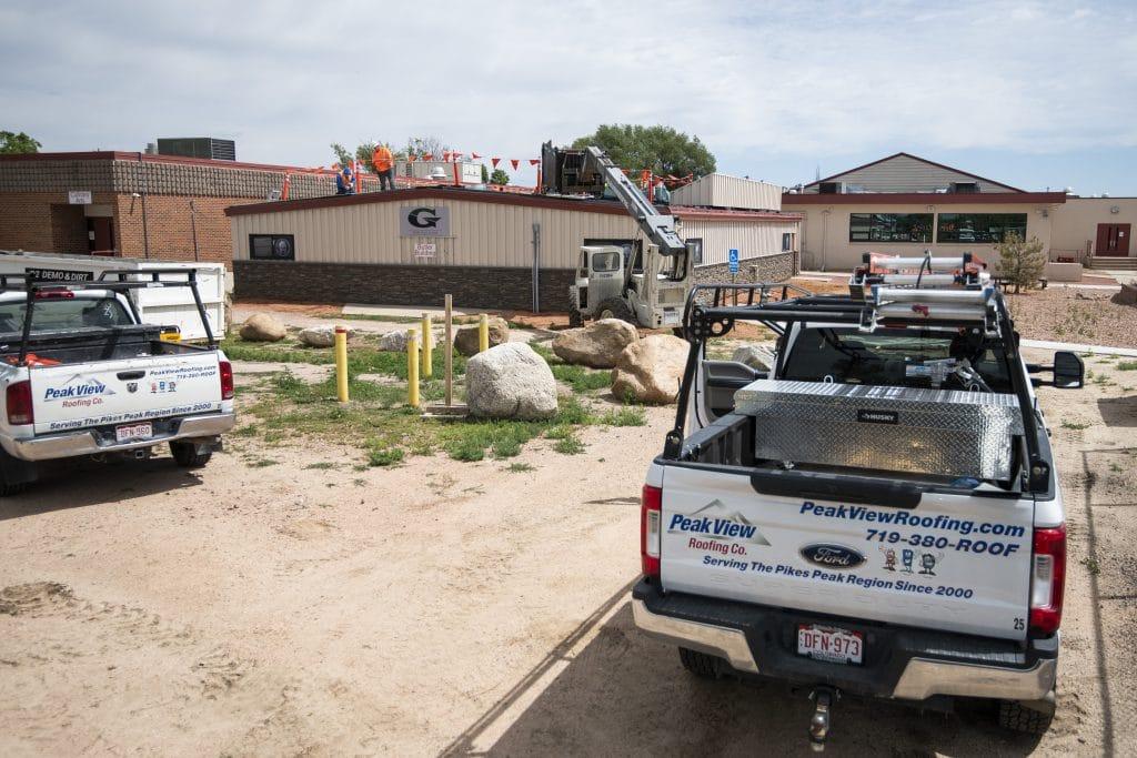 peak view roofing working on Goal High School roof repair