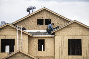 Two men working on a brand new roof