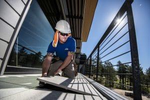 Man working on installing deck tile