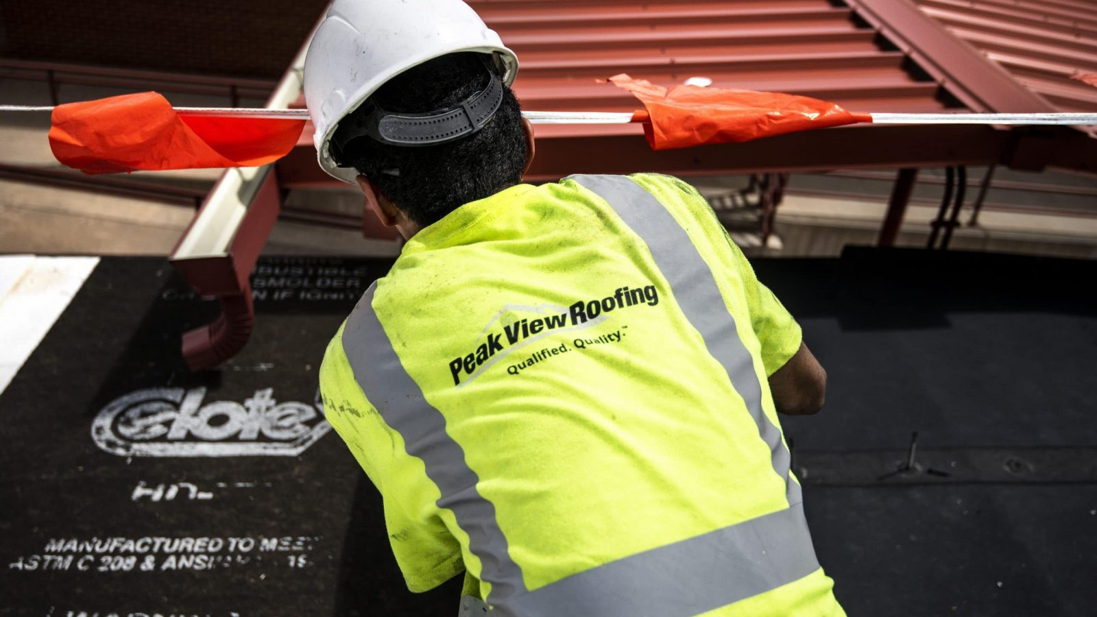 Commercial Roofer working on roof